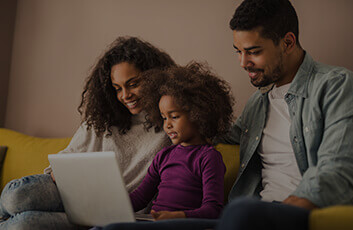 Parents and child using a laptop