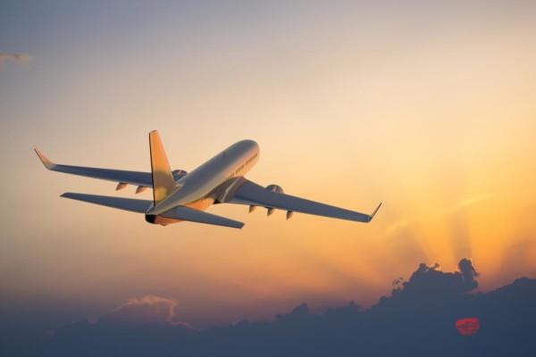 plane-flying-in-sunset.jpg